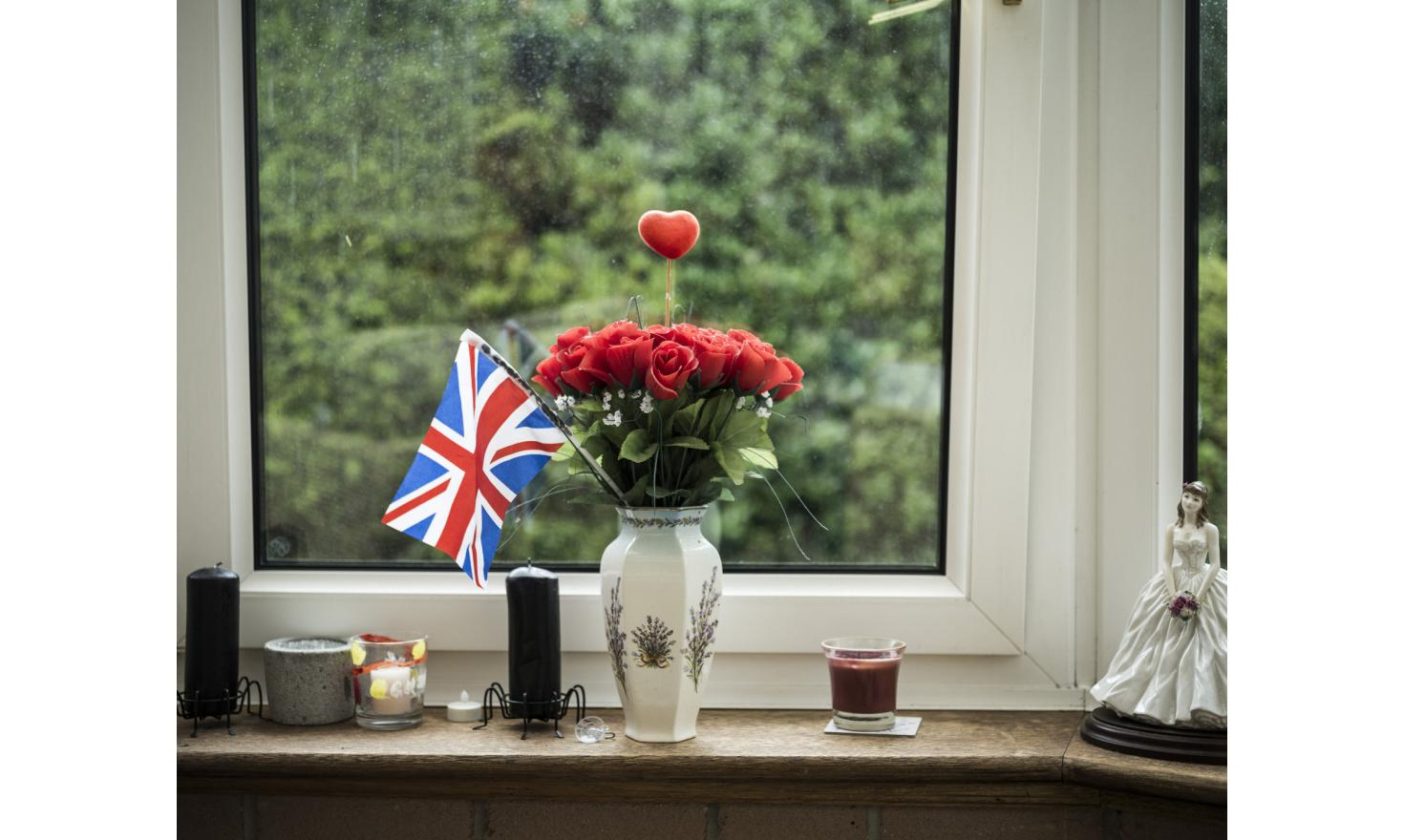 A bunch of roses, with a british flag and a love heart, in the sitting room of Ashley Greenup (56). Greenup is a fervent supporter of UKIP, living in Carlise. He voted to leave the EU in the British Referendum on EU membership.