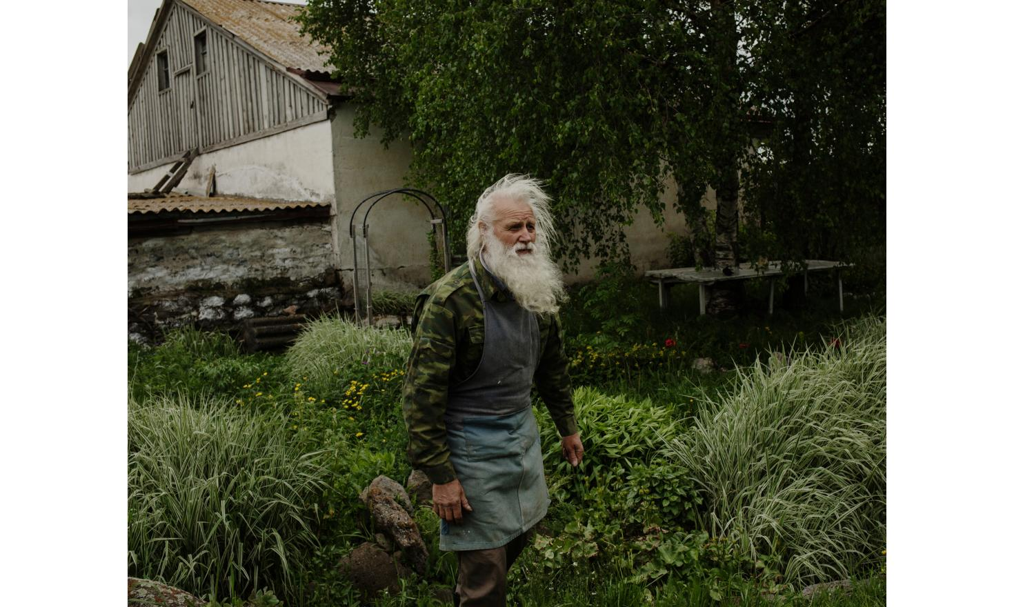 Nikolaï in the middle of his garden where he raises hundreds of different kind of herbs and flowers. He uses it for eating and traditional medicine. Doukhobors are know for their traditional way of life.