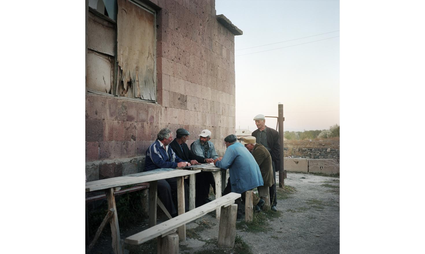 Every day they're here, it is the point of gathering for the old men of the village. They play cards, talk, play with their rosaries and tell how life has become difficult here.