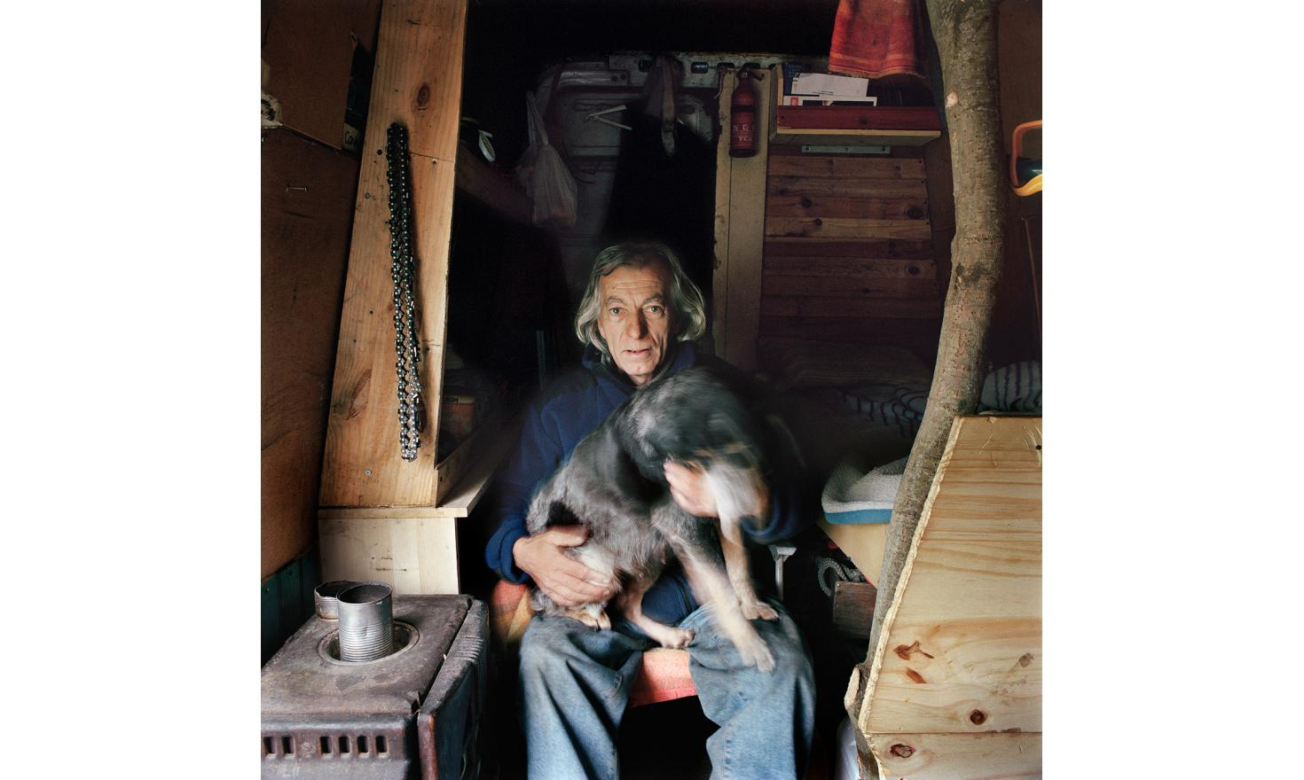 Maurice and his dog «Pitchoune».. His house is now his old Ford Transit van. Maurice does not stay in the same place, he loves to travel, moving from one place to another, he  comes regularly in Saint-Girons, in this quiet place of Ariège.