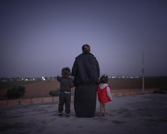 Jihane, 30 years old, and her two children from an ISIS father, are currently hiding in a safe house in Syria.
