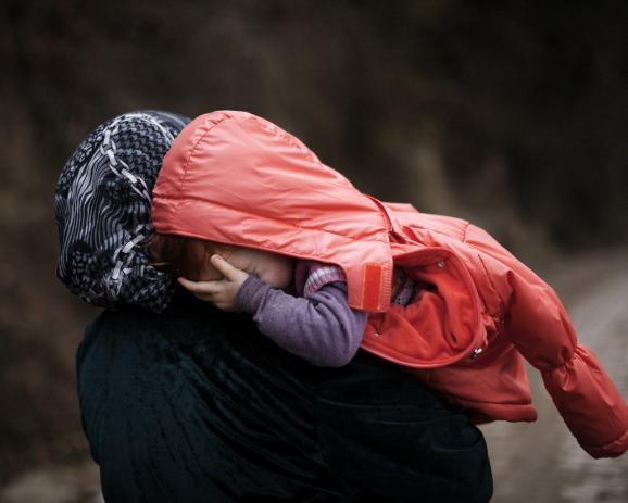 A mother and her daughter. Many refugees had no place in camps, they are on their own, without legal status.