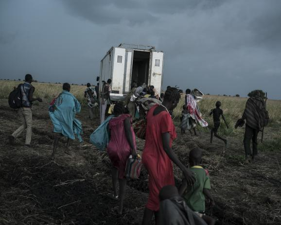 On the road to Ethiopia, displaced people hope to go back inside the boded down truck. South Sudan, May 6th 2017.